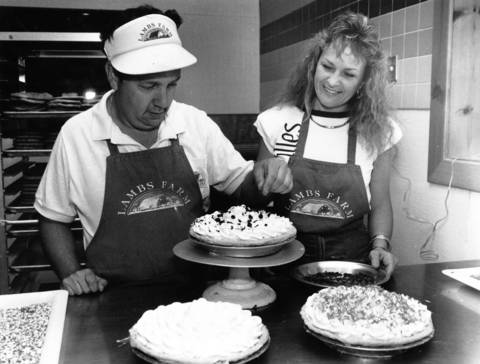July 12, 1990: Randy Pomerance gets some assistance from assistant manager Mary Ann Russell at Grandma's Bakery at Lambs Farm in Libertyville.