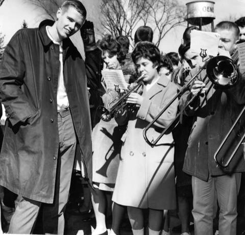 March 22, 1963: At right, Bob Johansen, a Geneva High School athelete, listens to Viking Victory March during a rally.