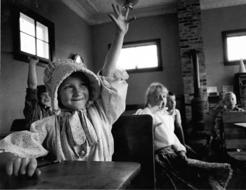 May 16, 1988: Cori Kane, 7, raises her hand to answer a question as 2nd grade students from Plato Center Elementary School spent a day reliving the past at the historic Pioneer Sholes School near St. Charles.
