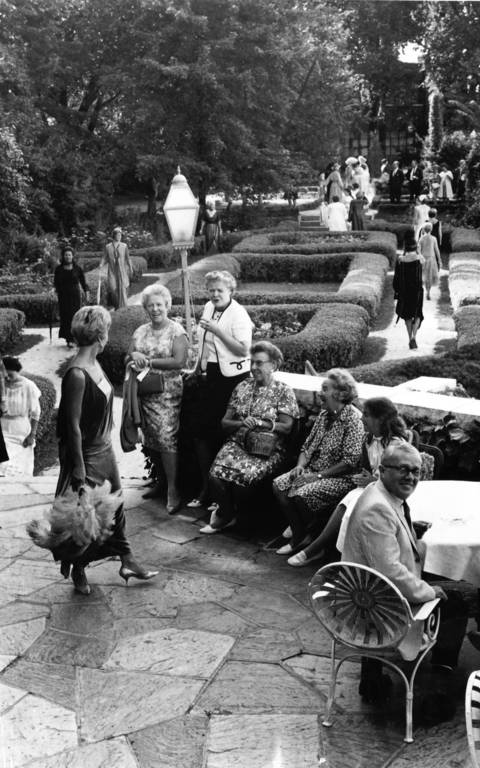 July 30, 1967: Guests gather on the terrace outside Baker Hotel in St. Charles, which overlooks the river.