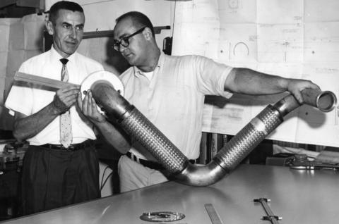 Sept. 6, 1962: A fuel transfer line used in ground support equipment for the Atlas booster rocket is examined by W.E. Schramm, left, chief test engineer of D.K. Manufactoring Company in Batavia, and Gordon Mullin, test lab technician. The company uses 100-year-old one-time farm equipment plant to make components for rockets, missiles and interplanetary space age vehicles.