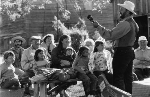 Oct. 6, 1989: The crowd gets a double treat as they listen to Reid Miller, of Madison, Wisc., play the banjo while telling a story at the 8th annual Fall Festival at the historic Garfield Fram in Geneva.