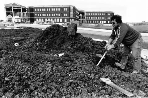 Oct. 24, 1990: Joe Salinas of Halloran and Yaugch construction company digs a spot for a sprinkler system at the site of what will become the new Delnor Community Hospital in Geneva.