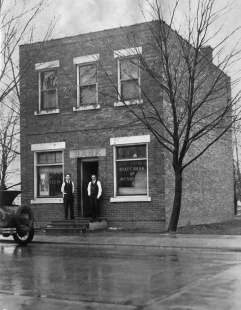 April 4, 1931: The State Bank of Mundelein in 1931, where a cashier was forced to open at daybreak after his family had been held prisoner by thieves for 12 hours. The robbers got away with $10,000.