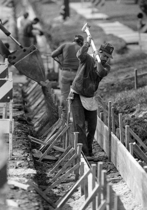 April 23, 1991: Jesse Guttirrez of Addison swings a sledgehammer while putting in new curbs on Seymour Avenue in Mundelein, Ill., in 1991.