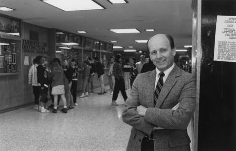 March 3, 1989: Jim Shepherd, a divisional supervisor in charge of student discipline, poses for a portrait while students walk the halls of Mundelein High School in 1989.