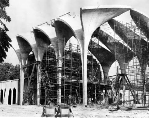 "Oct. 18, 1963: Gracefully arched concrete ""fan vaults"" rise amid steel scaffolding on the site of the new temple of North Shore Congregation Israel."
