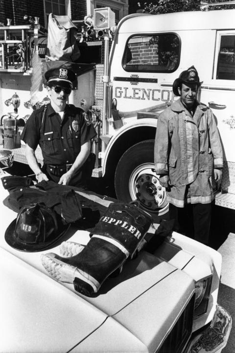 Sept. 12, 1977: Officer Terry Weppler (left) also serves as a fireman when needed. On the right is full-time fireman Robert Martell.