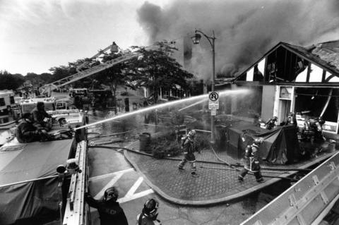 Aug. 25, 1989: Firefighters turn their hoses on a blaze that damaged shops and medical offices in downtown Glencoe. Engine companies from several communities assisted in fighting the fire.