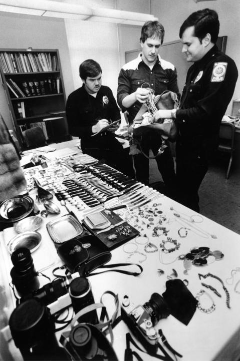Jan. 6, 1981: Glencoe police officers (from left) John Cegielski, Floyd Mohr and Steve List inventory items recovered from two students.