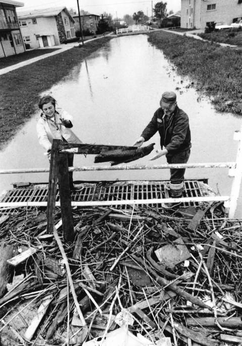 May 17, 1974: Don Krueger and Fred Lange clear the Midlothian Creek near 146th Street after heavy rains caused flooding in the village.