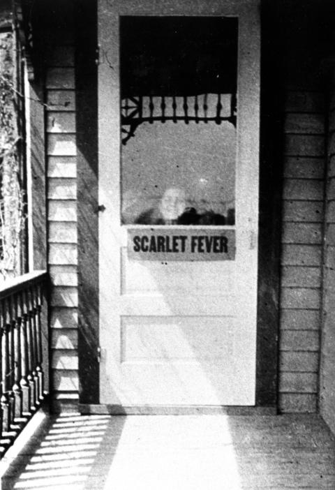 Date unknown: A patient looks out the window at the infirmary on Center Road for children struck with scarlet fever.