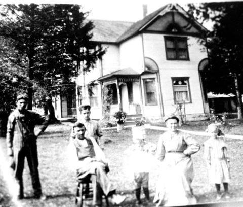Date unknown: A copy of a photograph of Harold Scheer and his family on their farm off of Route 45 in Frankfort.