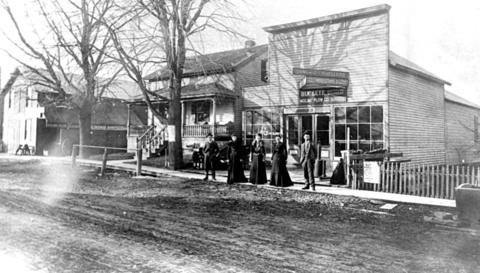 Date unknown: The Warner family stands in front of their family-owned storefront.