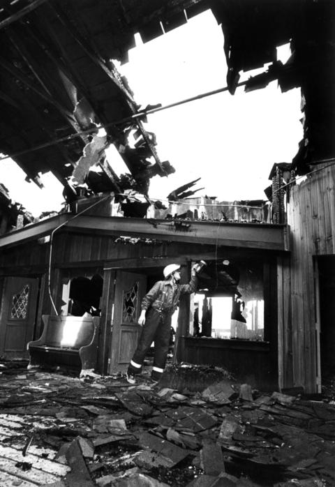 Oct. 22, 1984: Frankfort firefighter Al Wallace surveys the damage on the second level of the Grainery after a fire swept through the shopping center.