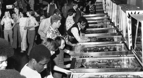 Feb. 5, 1976: Children and teenagers use the pinball machines at the Town Arcade in Bolingbrook's Old Chicago, a combination shopping mall and indoor amusement park.