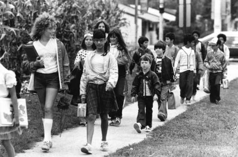 Aug. 31, 1982: Notebooks and lunchboxes in hand, students arrive for the second day of the school year at North View Elementary School in Bolingbrook.