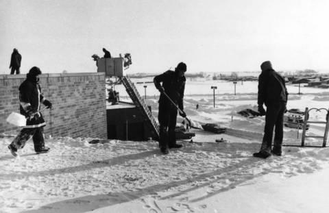 Jan. 31, 1979: Firefighters remove snow from the roof of Bolingbrook High School.