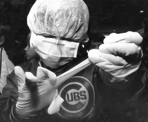 """Oct. 22, 1985: Robby George, a student at Oak School in Hinsdale, tries to remove a rubber glove during the """"Pediatric Tour"""" of Bolingbrook Medical Center, which is designed to ease children's fears of hospitals."""
