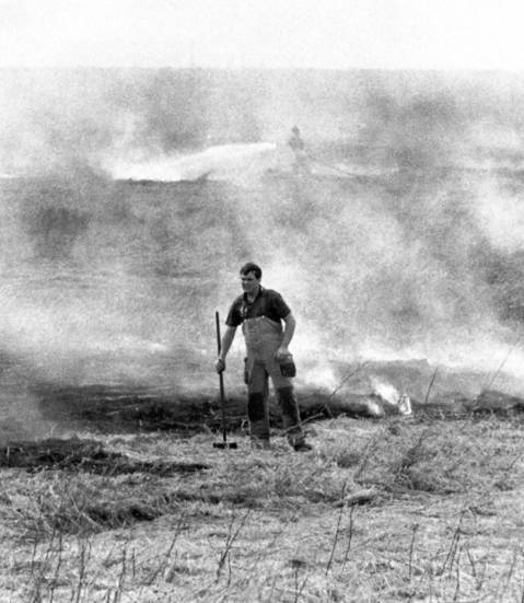 May 25, 1990: A firefighter works on a grassfire in Bolingbrook near Route 55.