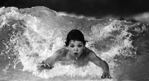 April 21, 1988: Dan Moran, 10, rides a wave at Bolingbrook Park District's Aquatic Center.