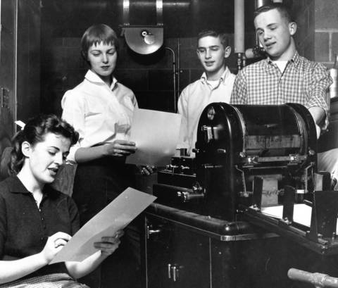 April 21, 1958: Ann Fletchalll, Chris Stearns, Doug Henning and Jerry Capoot at the mimeograph machine at the Corral in Western Springs.
