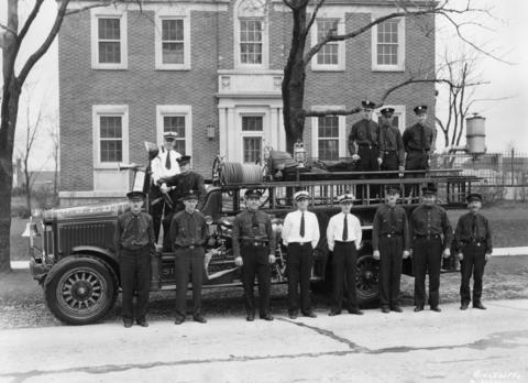 1933: The Western Springs Fire Department poses for a photo after receiving an honorable mention from the National Fire Protective Association for its activities during Fire Prevention Week.