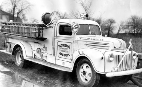 "Feb. 8, 1946: Mokena's new firetruck, equipped with a 500 gallon tank, 1,000 feet of hose and ""modern equipment."" Housed in the village's fire house, it also served New Lenox, Orland Park, Tinley Park and Frankfort."