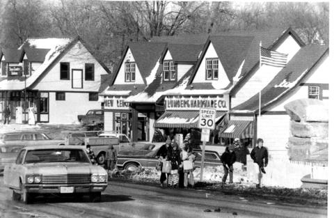 Feb. 10, 1974: Children on their way home from school walk past the lumber company, New Lenox's only industry at the time, situated on Cedar Street.