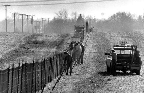 Nov. 14, 1990: Preparations for the first snowfall of the season made by Illinois Department of Transportation workers as they install snow fencing in a newly harvested cornfield along Cedar Road in New Lenox.