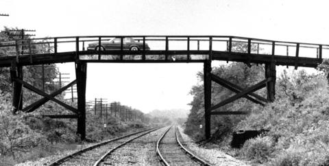 May 27, 1982: A car crosses the Old Marley Road bridge which spans over the Rock Island Railroad.