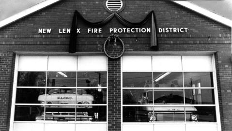 Jan. 22, 1983: Bunting hangs over the entrance to the New Lenox volunteer fire department's Station 2, commemorating the death of firefighter Kenneth Sobbe. Sobbe, 19, was killed on the way to a fire call.