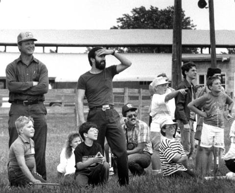 July 16, 1990: A group of model rocket enthusiasts watch as their rockets take flight at the Francis Road 4-H field near New Lenox.