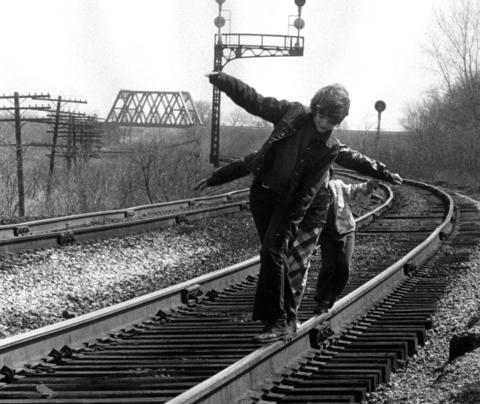 April 15, 1974: Kirk, Amy and Kathy Korista use the Rock Island railroad tracks as a balance beam.