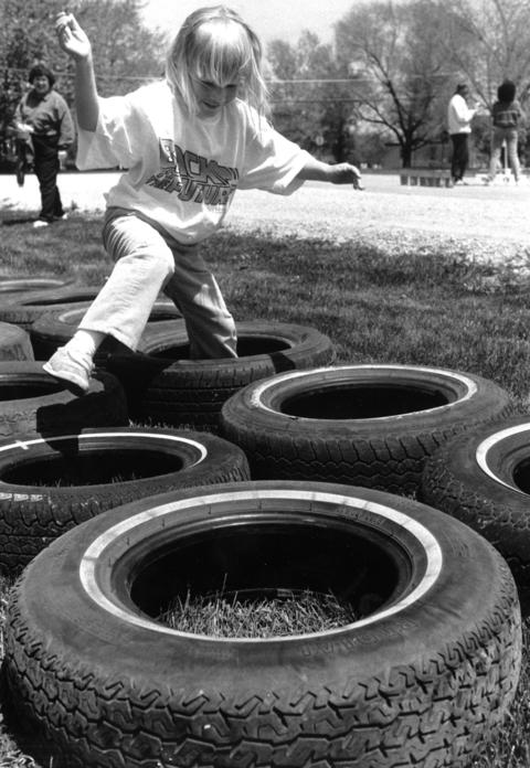 May 14, 1989: Kindergartener Elizabeth Romain, 5, races through a course made with used tires during Olympics Day at St. Mary's School in Mokena.