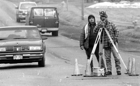 Feb. 5, 1991: Surveyors in Mokena lining up Wolf Road, due for a new coat of asphalt, are as concerned about staying out of the way of passing cars as getting the lines straight.