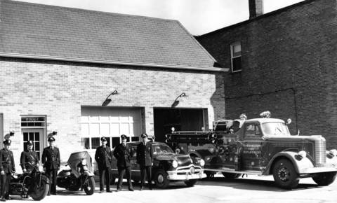 Oct. 7, 1951: The Barrington police force stand outside the 'new' police-fire department building. The department, which used to be a garage, was renovated. Its value, at the time, was $60,000.