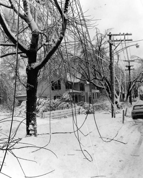 Jan. 26, 1965: Electric cables dangle into a Barrington street after a winter storm forced crews to cut them from damaged poles.