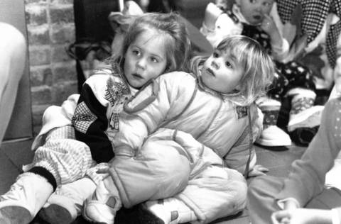 Jan. 25, 1992: Elizabeth Stephen, left, and Missy Dunn cuddle up while watching a puppet show at the Barrington Ice House Mall.