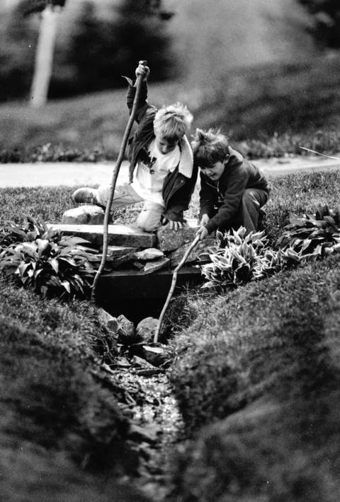 May 6, 1991: Brett Rogers, right, and Bill Mullen explore a ditch along Prairie Avenue in Barrington.