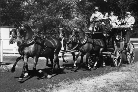 Sept. 17, 1953: John F. Cuneo, Chicago printing executive, rides atop a 150-year-old English coach with coachman and guests. The coach was previously used to transport passengers between London and Brighton.