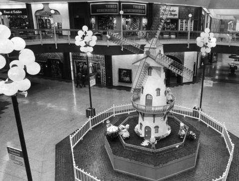 "March 21, 1975: At the hub of Hawthorn Shopping Center is a 26-foot windmill, providing a ""bit of whimsy."""