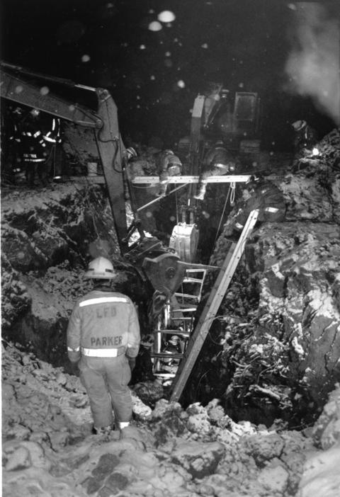 Jan. 11, 1991: Firemen work to rescue two men from a cave in at a construction site. One man died.