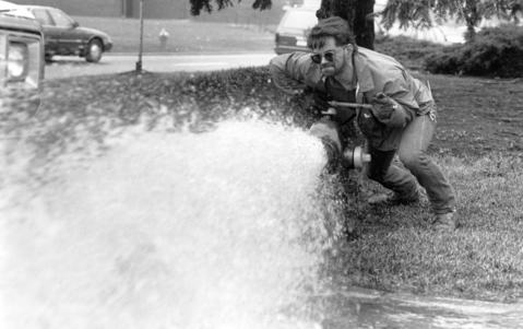 April 9, 1991: Onio Caraballo of the Lake County Public Works Department opens a fire hydrant to help flush out the community's water supply.
