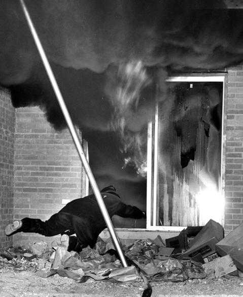 Oct. 14, 1963: A Des Plaines fireman appears to be diving toward the flame, but is actually trying to avoid it while fighting a fire at apartment buildings at 950 Beau Drive.