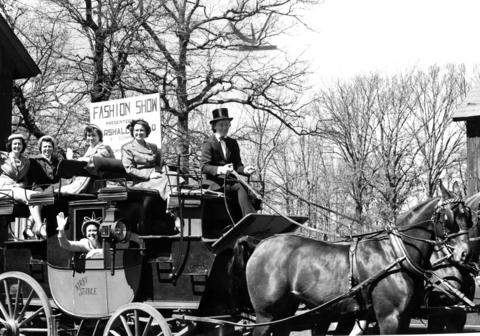 April 13, 1961: Women of the Des Plaines First Methodist Church, atop a vintage 1849 English road coach, are off to gather a crowd for their upcoming fashion show.