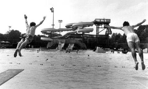 July 14, 1989: Patrons dive into the new Rand Park pool in Des Plaines; two 300-foot slides are visible in the background.