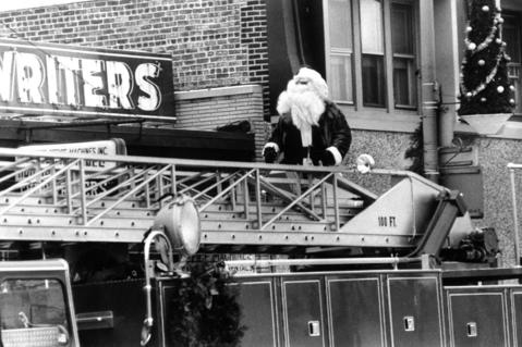 Dec. 9, 1972: Santa rides through downtown Des Plaines in a different type of sleigh: a fire truck.