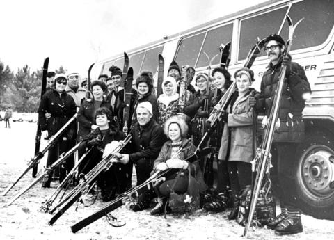 Dec. 17, 1969: Members of the Des Plaines 400 Ski Club prepare to embark on a ski trip to Mount Telemark in Cable, Wisc. Group leader Herman Heinemann is kneeling in the center.
