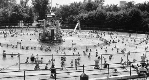June 27, 1952: Youngsters and adults alike cool off in Roosevelt Park's spacious circular pool. Measuring 160 feet in diameter, the pool is designed with the deep inner circle fenced off from the shallow outer circle for safety.